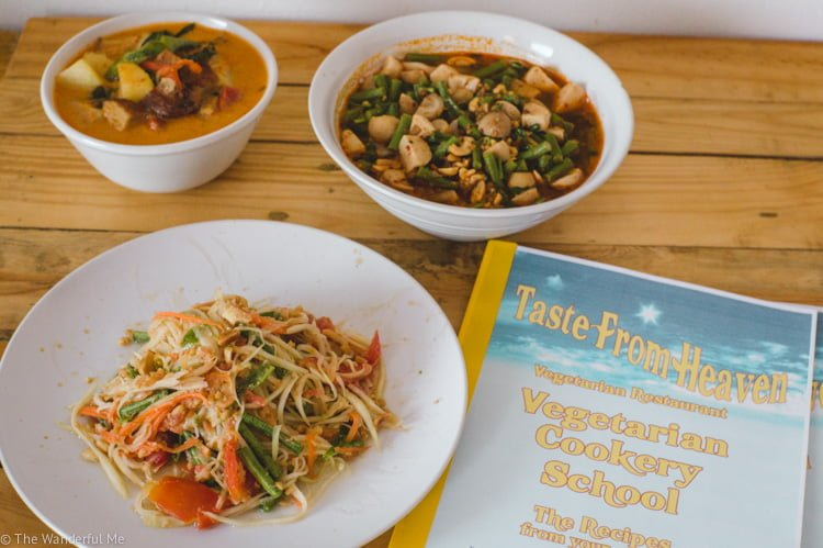 Taste of Heaven recipe book you can take home once done with their vegan cooking class in Chiang Mai next to some fresh papaya salad, vegan duck curry, and vegan Tom Yum soup.