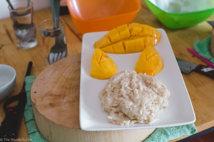 Vegan mango sticky rice sitting on a pristine white plate.