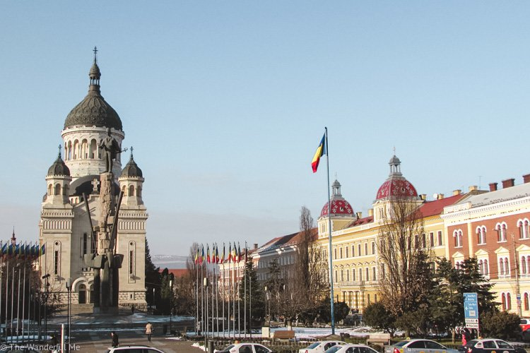 A photo of a church and colorful buildings in Cluj-Napoca.