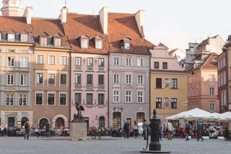 Crayola-colored buildings that line one of the main squares in Warsaw, Poland.