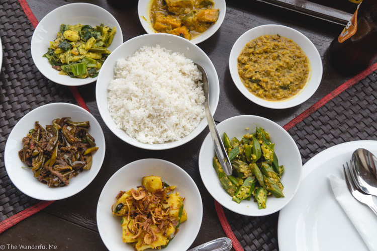 A spread of 6 different vegan curries, including dahl, okra, eggplant, and potatoes, from the Jade Green Tea Centre and Restaurant.