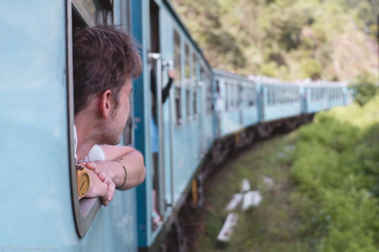 Dan looking out the train window while venturing from Ella to Kandy in Sri Lanka.