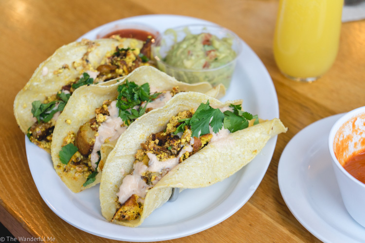 The yummy-looking breakfast tacos from J. Selby's (with a nice side of mimosa).