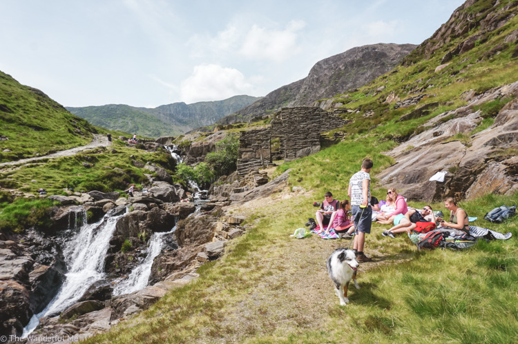 Group of friends having a picnic on Watkins Path in Snowdonia National Park, a must-visit attraction in Wales!