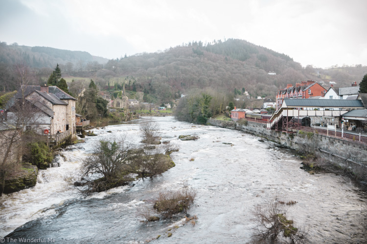 Llangollen village hugging the River Dee with views of the Railway Station and far off hills.