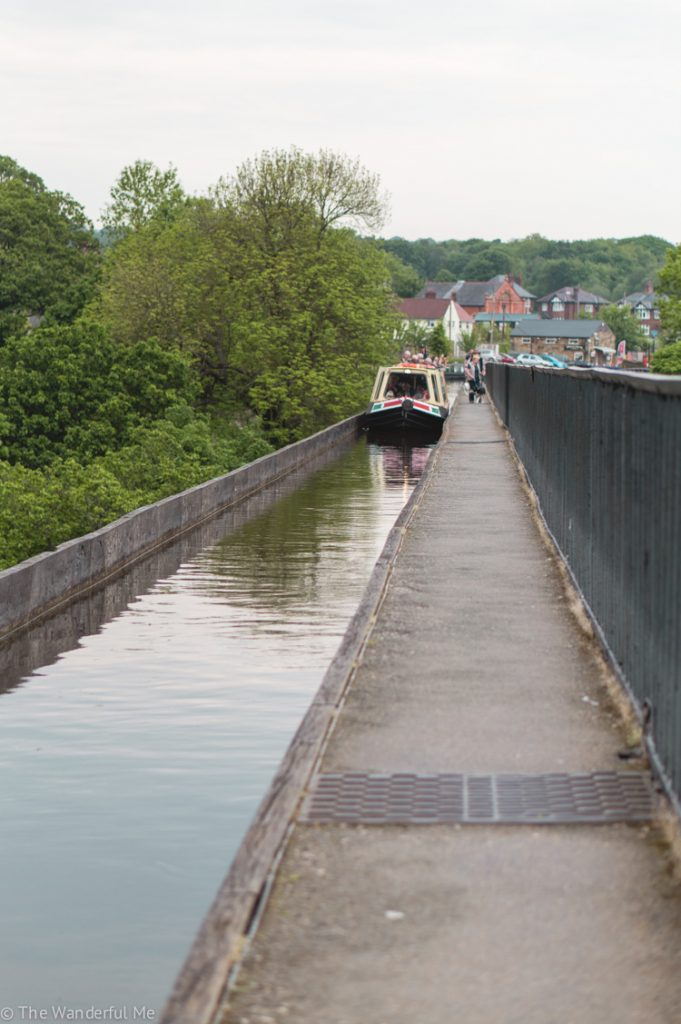 A boat chugging across the Pontcysyllte Aqueduct.