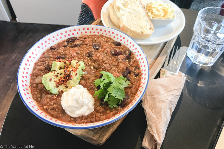 Creamy vegan chili topped with fresh cilantro (aka coriander), avocado, and Oatly creme fraiche. Also a side of fresh sourdough bread and creamy vegan cheese!