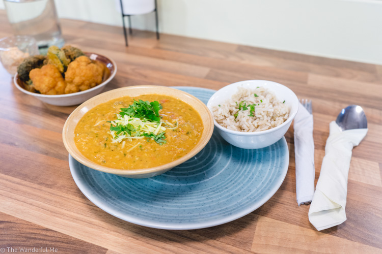 The Verdes Vegan lentil dahl dish with a side of brown rice and tempura vegetables!