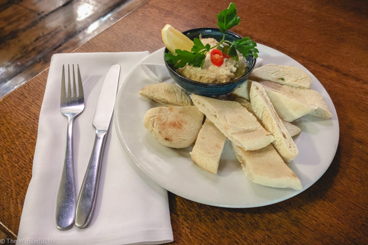 Vegan hummus + flatbread at the Artichoke Cafe Bar Bistro, a great place for vegan small plates and drinks in Chester.