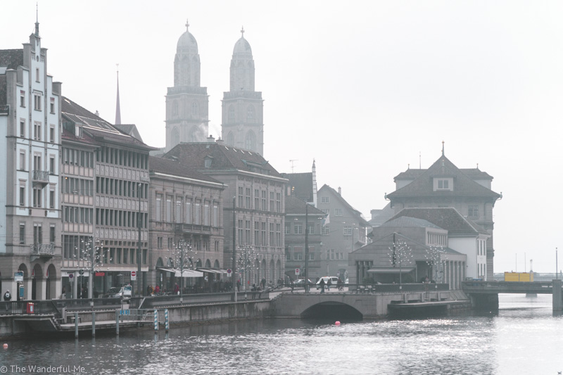 A view of Zurich with two church towers and the gorgeous architecture.