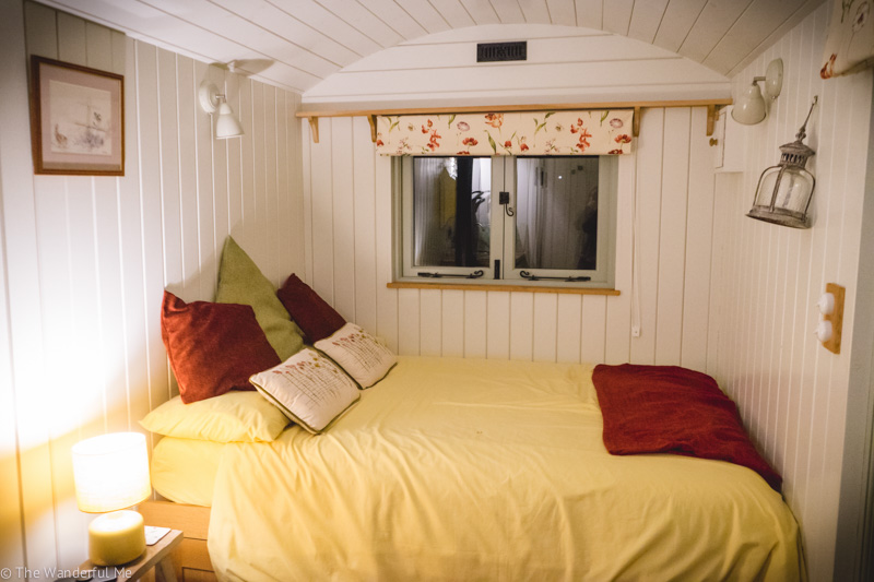 A view of the Shepherd's Hut bed and window.