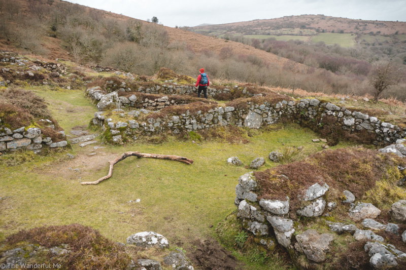 Dan walking through Hound Tor Deserted Medieval Village.