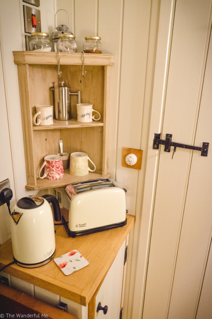 A toaster and kettle are situated in one of the hut's corners.