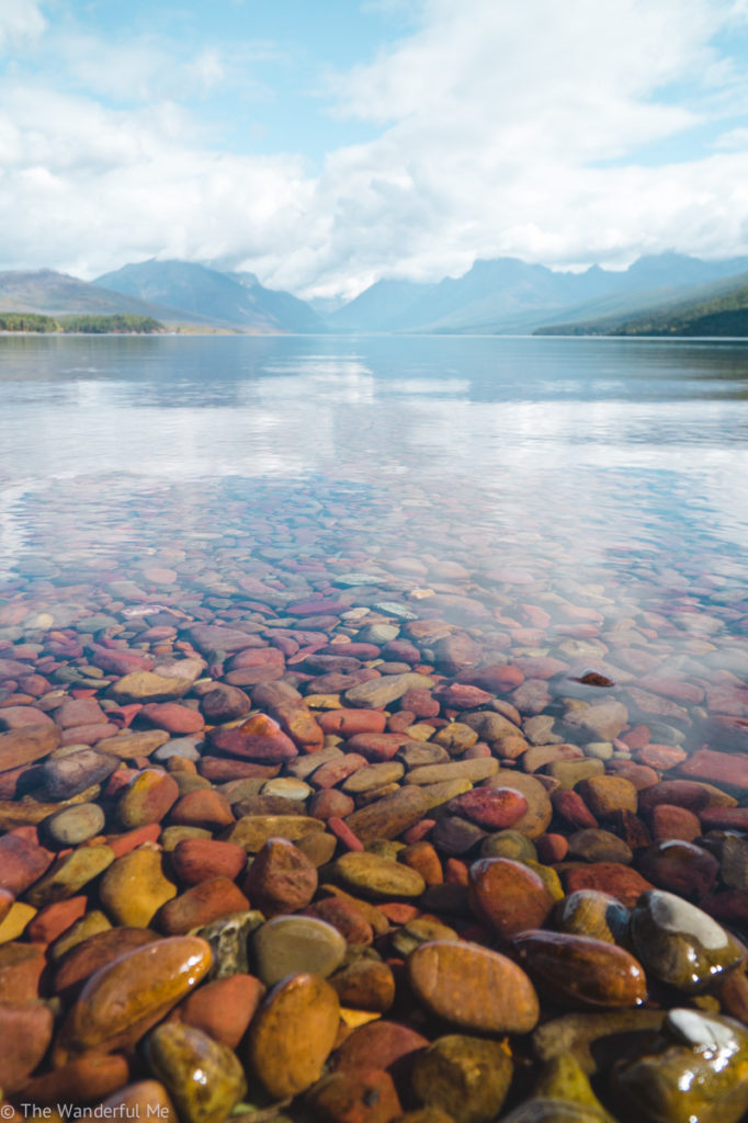 Rocks of all colors - like yellow, orange, and red - are found in Lake McDonald.