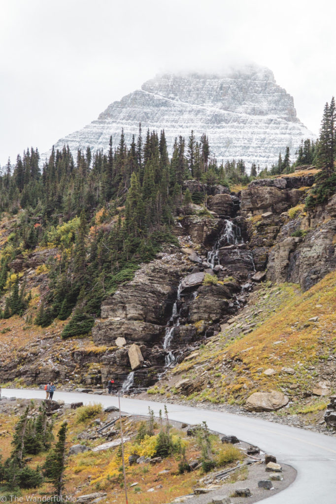 One of the many waterfalls in Glacier National Park that's near a road.