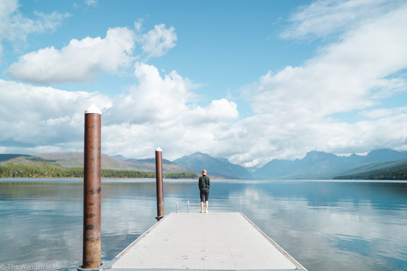 Dan standing on a dock looking over Lake McDonald in Glacier National Park, Montana.