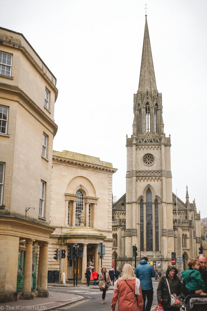 One of the view's of Bath's streets, with the beautiful golden stone and a towering church in the background.