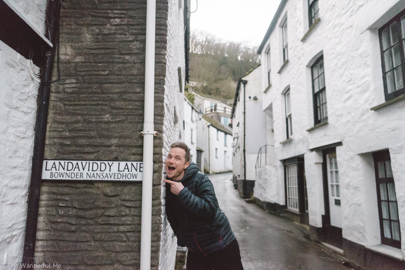 "Dan, the wanderful boyfriend, standing in front of a street sign in Polperro that reads ""Landaviddy Lane""."
