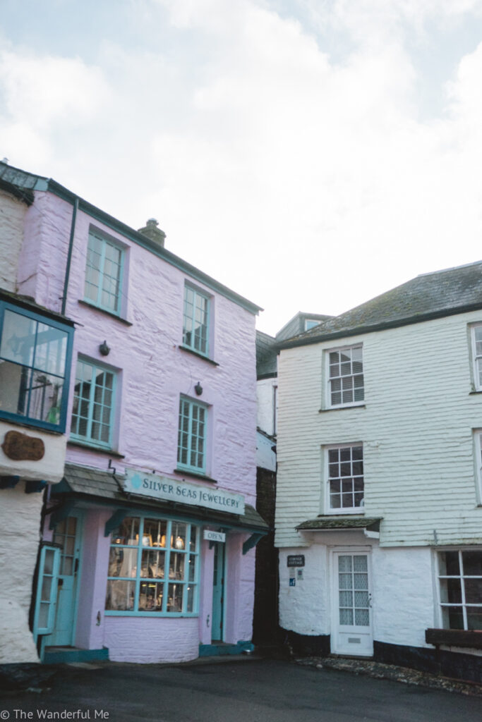 A pink and green building in Polperro.