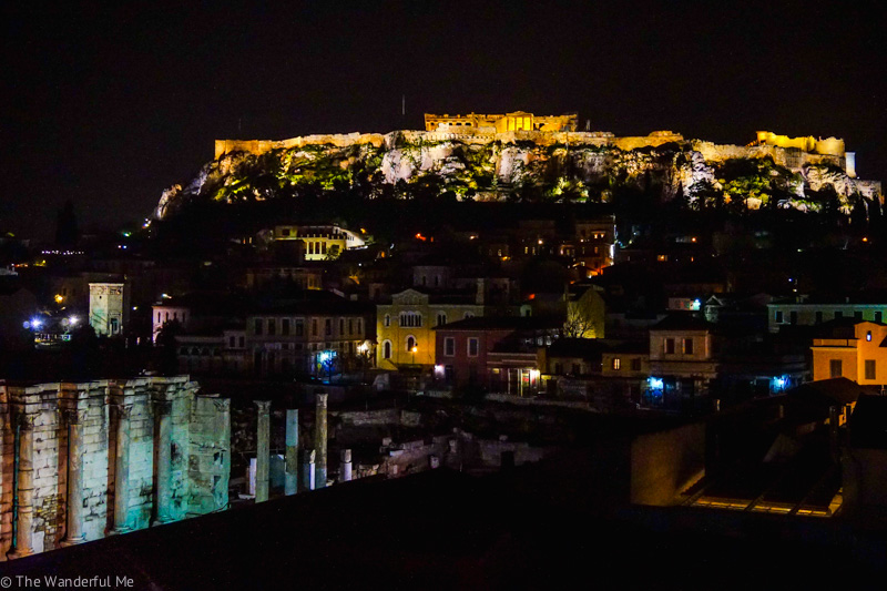 View of the Parthenon at night from a rooftop bar in Athens, which is one of my favorite fun things to do in the city.